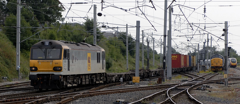 92003 Beethoven, 4S62, Carnforth, Wed 26 July 2006 - 1608.  There were only four containers on EWS's 1212 Daventry - Mossend.  At right is 37029, running north light engine.  The Pendolino had worked a Euston - Lancaster service, and recessed to Carnforth before returning to Euston.  (This was a regular diagram at the time.)