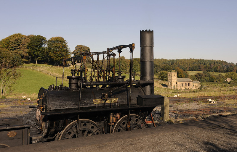 Replica Locomotion No 1, Pockerley Waggonway, Beamish, Mon 8 October 2012 1.  The replics was built for the 150th anniversary of the Stockton & Darlington Rly in 1975.  The medieval church has come from Middlesborough.