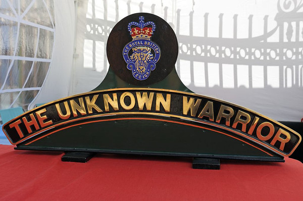 'The Unknown Warrior' nameplate, Tyseley, Sun 26 June 2011.  The LMS-Patriot project appeal hope this nameplate will be carried by new Patriot 4-6-0 45551.  The splendid choice of name follows on from the first of the original Patriots.  It was originally built as a Bowen-Cooke Claughton four-cylinder 4-6-0 in 1920, and was treated as a memorial to LNWR staff killed in the First World War, being given the evocative number and name 1914 Patriot.  It was comprehensively rebuilt in 1930 as the first of Fowler's new design of three-cylinder 4-6-0, and kept its Patriot name until withdrawal in 1961.  The original 45551, built new in 1934 and withdrawn in 1962, was never named.  (Its number is being re-used because 45552 and higher numbers were assigned to the Jubilee 4-6-0s, Stanier's development of the Patriot design.)