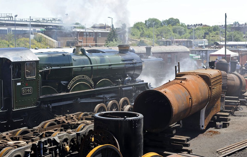 5043 Earl of Mount Edgecumbe & 7029 Clun Castle (boiler), Tyseley, Sun 26 June 2011.  7029's smokebox is standing upright in front of the boiler.