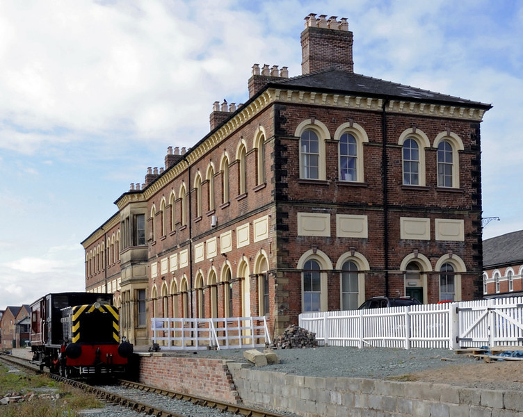 Cambrian Railways station and office building, Oswestry, Fri 26 August 2011.   NB that the platform, demolished after the line closed to passengers, is being reinstated.  The diesel is Telemon, Vulcan Foundry 0-4-0DM D295 / 1955.