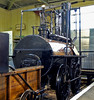 Stockton & Darlington Rly No 1 Locomotion, Darlington North Road, 15 November 2009 8    Water was fed to the boiler by the pump seen here below the nameplate.  It was driven by the front cross-beam.  As a result, the boiler could not be replenished if the loco were stationary.