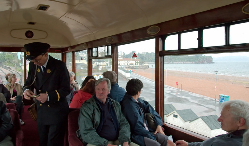 Welcome to the Dartmouth Steam Railway!    The ticket inspector collects the £1 supplementary fare levied for travel in the former Devon Belle observation car as it passes Goodrington Sands on its way to Kingswear on 17 May 2008.