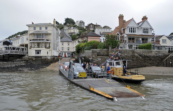 Dartmouth lower ferry, Kingswear, Sun 2 September 2012 .  The lower ferries comprise an unpowered pontoon attached to a tug.  They are owned and operated by the local council (South Hams).  Kingswear station is at far left.