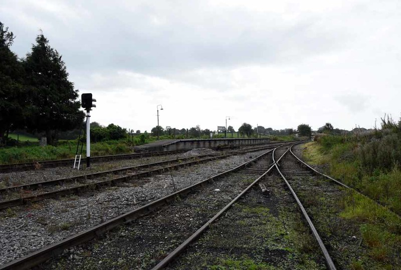 Cranmore West halt, 6 September 2017.  Looking west, towards Mendip Vale.  Preservation started at Cranmore when wildlife artist David Shepherd needed a home for 75029 and 92203.  He bought land at what is now Cranmore West and established a depot.  An engine shed was built and the ESR opened in 1975, initally offering brake van rides behind the two locos.  The platform came from Ilton halt, on the closed Taunton - Chard line.  All the buildings at Cranmore West are new.