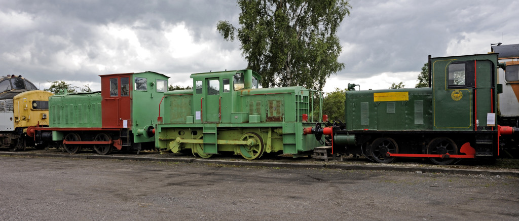 The 'Whitehaven 3' at Warcop on Sun 10 July 2011.  These diesels used to be at the Haig Colliery museum, Whitehaven, but came to the Eden Valley Railway in September 2010.  At left is Vulcan Foundry 5262 / 1945, built under subcontract for Drewry Cars (2181 / 1945).  In the middle is Thomas Hill 130c / 1963, originally John Fowler 22971 / 1942.  At right is Hunslet 2389 / 1941, the only one of the three to have worked in Cumbria, at the Royal Naval Armaments Depot at Broughton Moor.  Partially visible are 37250 at left and 4-CEP 2311 at right.
