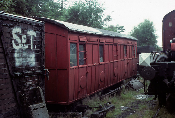 North London Rly second class coach, Haverthwaite, 1 August 1976.  Built at Bow, date and number unknown, and subsequently migrated to west Cumberland.  It ended as a grounded body at Ulverston before moving to Haverthwaite, where it is seen in this Les Tindall photo before restoration.