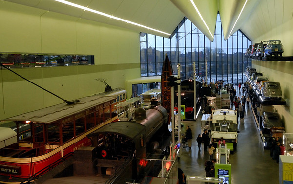 Riverside Museum, Glasgow, Sat 19 November 2011.  Despite the vast cost, the new museum is little bigger than its predecessor.  Here is part of the crowded  interior, with North British Rly No 256 Glen Douglas and South African Rlys No 3007 flanked by trams and a wall of cars.