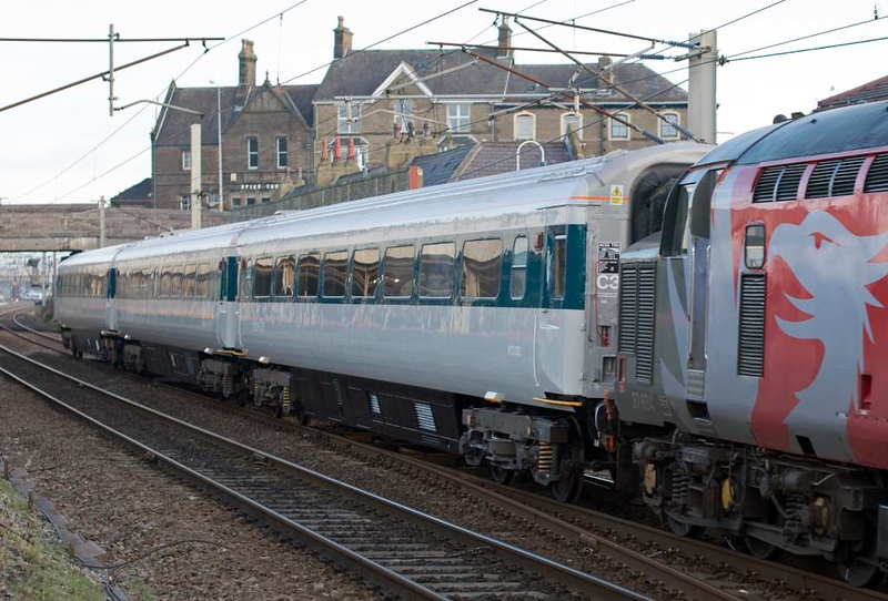 37884, 5Z37, Carnforth, Fri 12 February 2016 - 1047 2.  The 125 Group's Mark 3 coaches have been painted to match prototype HST power car 41001, with which they will run on the GCR Nottingham.