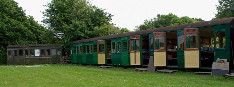 Carriage bodies, Havenstreet, 31 May 2008.    2403 at right was built by the LBSCR in 1903.  It never worked on the Island, although identical coaches did, so it was bought in 1991.  The body at left is from a 3 compartment coach.