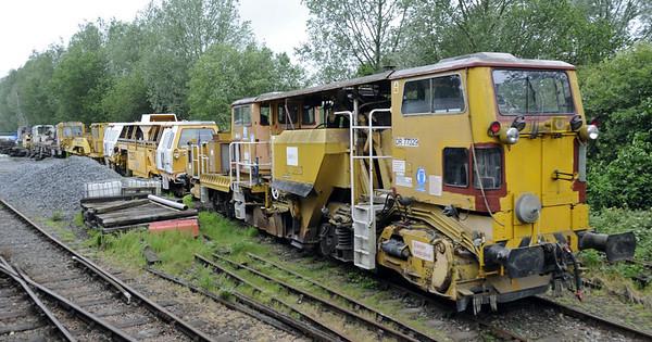 Track machines, Wittersham Road, Fri 8 June 2012.  Nearest is Plasser & Theurer USP 5000C ballast regulator DR 77329, then Plasser & Theurer 07-16 universal tamper DR 73250.  In the distance is Plasser & Theurer GP-TRAMM DR 98211.