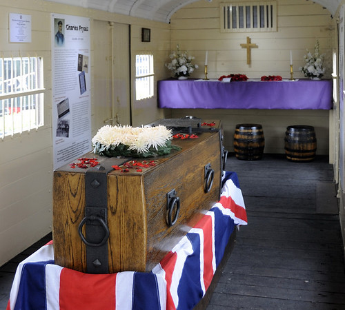 Cavell van, Bodiam, Fri 8 June 2012 2.  In 1920 the van was used to repatriate the body of the Unknown Warrior from the Western Front for burial in Westminster Abbey.  Here are three views of a modern reconstruction of the coffin on its catafalque.  The barrels contained soil from Flanders, in which the Unknown Warrior was buried in the abbey.