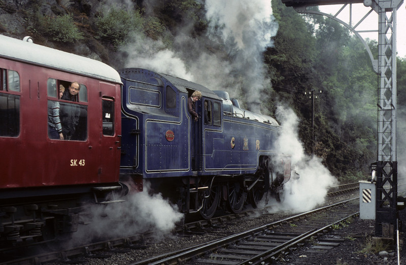 2085, Haverthwaite, 1 August 1976.     The Fairburn makes a cautious departure over wet rails with the first train of the day. Photo by Les Tindall.