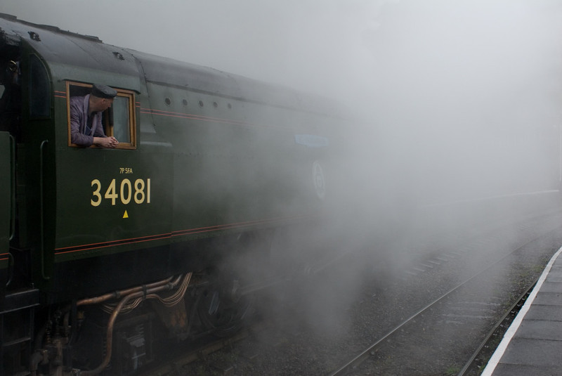 34081 92 Aquadron, Llangollen, 22 April 2007 - 1045.  34081 moves out of the station in a cloud of steam and rain.