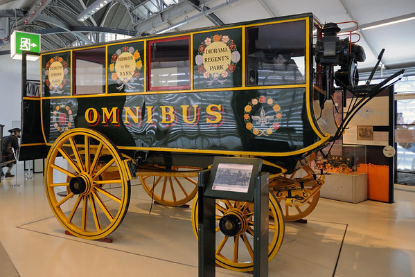 Replica of George Shillibeer's 1829 omnibus, London Transport Museum, Covent Garden, Sun 1 April 2012 1.  It was pulled by three horses, and ran from Paddington to the Bank (of England) at a fare of one shilling.  A novel feature was that it stopped frequently to pick up and set down passengers, a practice illegal until 1832.  Thereafter omnibuses multiplied, and by 1839 London had about 600.