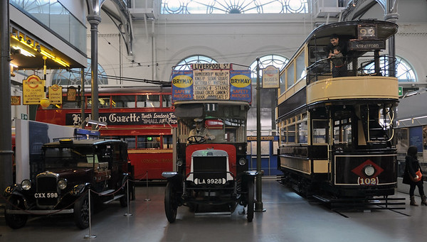 1936 Austin Low Loader taxi CXX 598, 1911 London General B-type petrol bus LA 9928 & 1910 West Ham Corporation tram No 102, London Transport Museum, Covent Garden, Sun 1 April 2012.  Behind is 1939 K2 class trolleybus EXV 253.