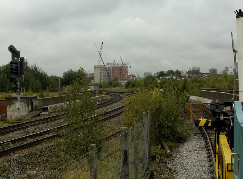 Ordsall Lane Junction, Manchester, 15 September 2005.  Looking west from Manchester Museum of Science & Industry.  Liverpool Road Station soon became a goods station after it was by-passed by a new line (just visible in the distance) which connected the Liverpool & Manchester with Victoria Station.  Another new line (visible at left) connected the L & M with London Road (now Piccadilly) Station.