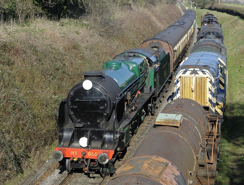 E850 Lord Nelson, Ropley, Sun 9 March 2014 - 1427.  Passing the stored locos as it arrives with the 1350 Alton - Alresford.