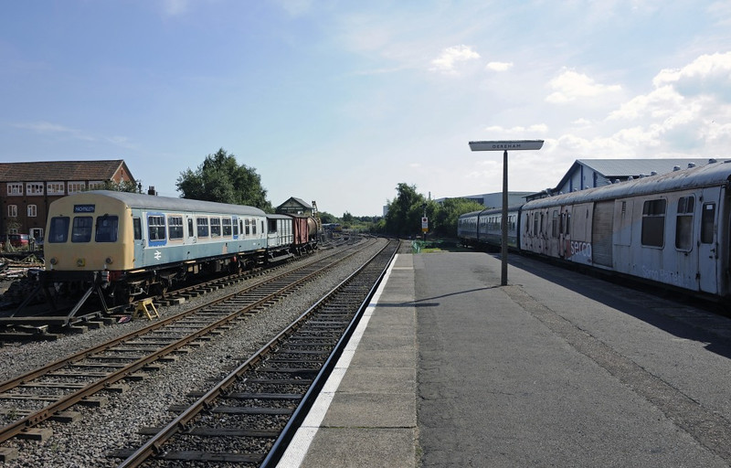 Dereham station, Wed 28 August 2013 2.  Looking south towards Wymondham Abbey.  51434 Matthew Smith 1974 - 2002 is at left, and 59117 and 51503 are at right.