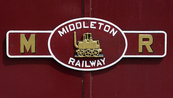 Welcome to the Middleton Rly, Leeds!  Sun 14 July 2013.  The railway originated as a wooden waggonway built to carry coal from pits at Middleton north to the industrialising city of Leeds, a distance of about 2.5 miles.  The waggonway's route was authorised by a 1758 Act of Parliament, the first time this had been done for rail transport. The waggonway had a gauge of 4ft 1in, and started to use iron edge rails from about 1800.  It used horsepower until 1812.  By then the cost of horses and their fodder had risen steeply on account of Britain's long war against Bonaparte.  In 1812 John Blenkinsop and Matthew Murray designed and built two cogwheel steam locos, and rack rails for them to run on. These were the first commercially successful locos ever built, and entered service two years before Hedley's Puffing Billy.  They were named Prince Regent and Salamanca, after Wellington's crushing victory over the French army near that Spanish city on 22 July 1812.  The first two locos having proven successful, two more were built in 1813.  By 1816 six other Blenkinsop / Murray locos were in use elsewhere in northern England.