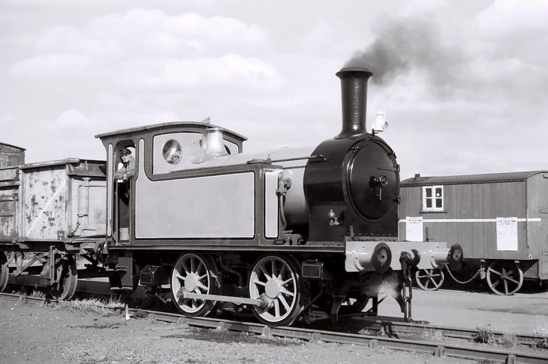 North Eastern Rly 0-4-0T 1310, Parkside, 2 July 1966 1.  The NER built 1310 at Gateshead in 1891.  It became a member of LNER class Y7.  Another Y7 survives, No 985, built at Darlington in 1923 and now based at the Beamish Open Air Museum.  1310 came to the Midldleton in 1965, and was still there in 2013.  NB that although just repainted, the loco has yet to acquire its NER branding.  The posters on the van advertise a steam traction engine and fair organ rally.