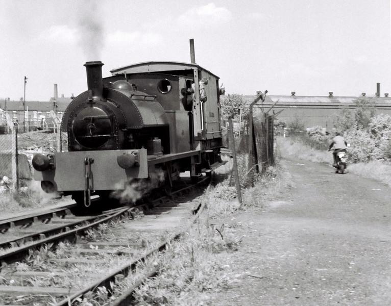 Bagnall 2702, 15 May 1966 2: Dartmouth branch.  Having crossed Moor Road and reversed on the Parkside headshunt, the Bagnall propels the brakevan up the Dartmouth yard branch into Clayton's works on Garnet Road.