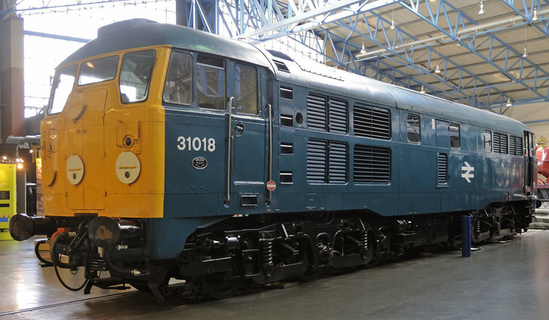 31018 (D5500), National Railway Museum, York, Sat 8 September 2012.  Built in 1957 by Brush, first of 20 1250hp Mirrlees-engined A1A-A1A locos ordered under BR modernisation pilot scheme.  243 more class 31s were buiilt.  All, including the pilot scheme locos, subsequently had their Mirrlees engines replaced with 1470hp English Electric units, and a few are still in service in 2012 working Network Rail test trains.  31018 was withdrawn in 1976.