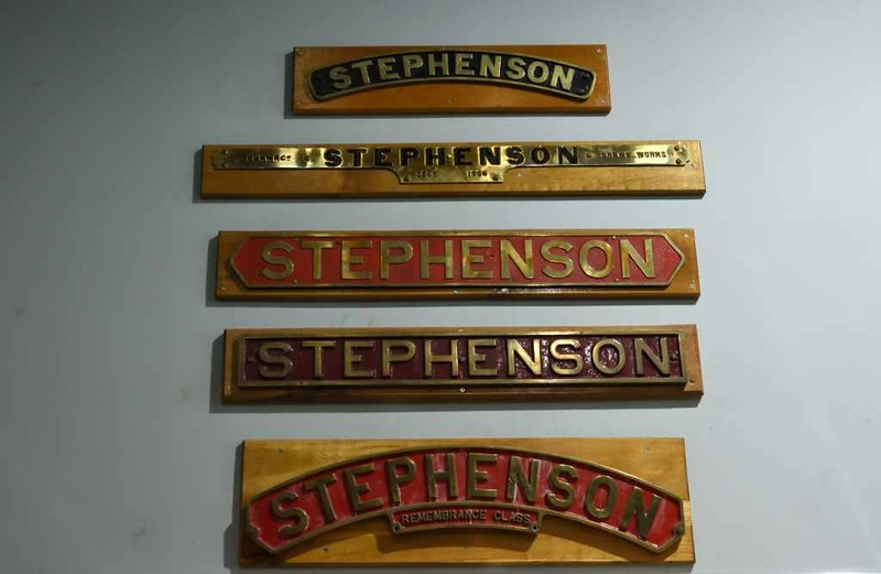 Stephenson nameplates, Locomotion, National Railway Museum, Shildon, 26 September 2017.  The plate at top was carried by Patriot 45569.  The plate below comes from LNWR Experiment class 4-6-0 2052.  It was built at Crewe in December 1906 and badly damaged in the high speed derailment at Shrewsbury on 15 October 1907 in which 18 people were killed including the driver and fireman.  The loco was repaired and worked until December 1930.  The plate at bottom was carried by LBSC Remembrance class 4-6-4T 2329 built in 1921. In 1934 it was rebuilt as an N15X class 4-6-0 by the Southern, and withdrawn in 1956 as 32329.