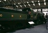 Great Northern Rly 4-2-2 No 1, National Railway Museum, York, 2 October 1976.  Patrick Stirling's 1870 'Single', famous for its 8ft driving wheels.  Previouly on display at the old York museum.  In 2017 at NRM York.  Photo by Les Tindall.