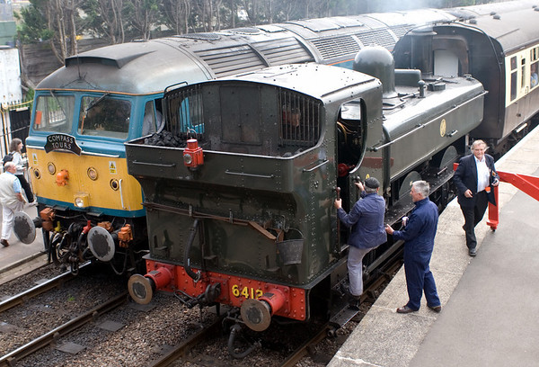 6412, Bishops Lydeard, 14 April 2007 - 1222.  6412's crew prepare to work the 1225 to Minehead.  The tour reached Bishops Lydeard 30 minutes late at 1210, but the WSR made it follow their all-stations stopper.  As a result the tour did not stagger into Minehead until 1410, 75 minutes late.