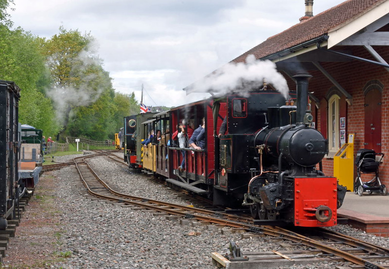 Apedale station, Sun 17 May 2015 1.  Newly-restored Hudswell Clarke 0-6-0WT Ashanti Goldfields Corporation No 9 arrives at the Apedale Railway's main station and visitor centre.  On the rear is Kerr Stewart 0-4-2ST Stanhope,