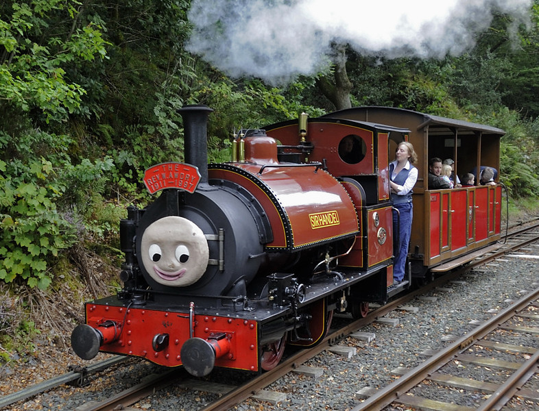 'Sir Handel', Abergynolwyn, Thurs 25 August 2011.  The loco is in fact Talyllyn Rly No 3 Sir Haydn, originally Corris Rly No 3.  It is an 0-4-2ST, built by Hughes (323 / 1878) at Loughorough in the Falcon Works, future home of Brush Traction.  The headboard commemorates the creator of the 'Thomas the Tank Engine' stories, who was a member of the Talyllyn Rly Preservation Society for many years.