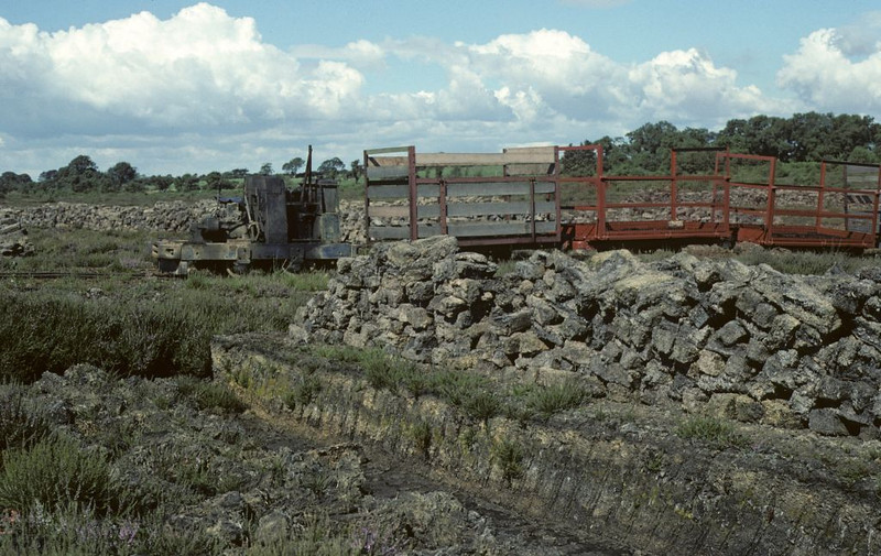 A third view of the Ruston and its peat wagons, with cut peat awaiting loading in the foreground, Cumberland Moss Litter Industry Limited, Kirkbride, Wigton, 31 July 1976.  Photo by Les Tindall.