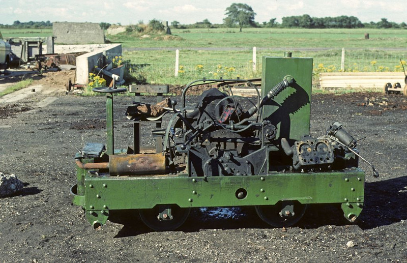 Motor Rail 4wDM 8863 / 1944 partly dismantled just outside the works, Cumberland Moss Litter Industry Limited, Kirkbride, Wigton, 31 July 1976.  Photo by Les Tindall.