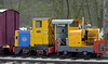 Top & tail super power on the Derbyshire Dales Narrow Gauge Rly, Rowsley South, Sun 9 May 2010 3    A closer look at blue and yellow 85049 (Ruston 393325 / 1956), with Motor Rail 22070 / 1960 dwarfed by the tail lamp.