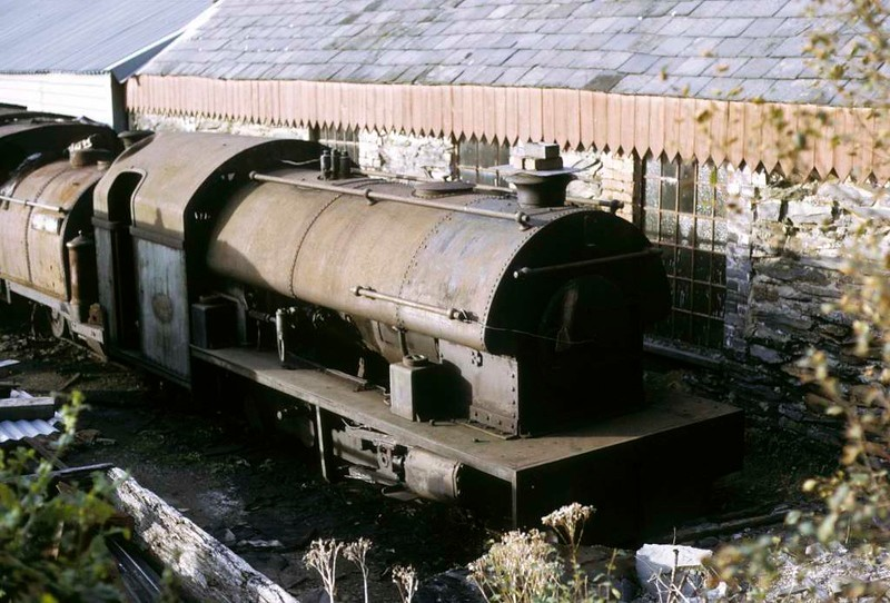Welsh Pony & Harrogate No 1, Boston Lodge, Porthmadog, 5 October 1974.  The Pony is George England 0-4-0STT 234 / 1867, still on the Ffestiniog in 2017.  Harrogate is Peckett 0-6-0ST 2050 / 1944, in 2017 preserved at Statfold Barn.  Photo by Les Tindall.