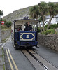 Great Orme Tramway No 4 St Tudno, approaching Victoria station, Llandudno, Sat 20 August 2011.  The lower section is much the steeper of the two with a maximum gradient of 1 in 3.8.  Its trams have been fitted with emegency slipper brakes since a fatal accident in 1932 when a tram broke free from its cable.