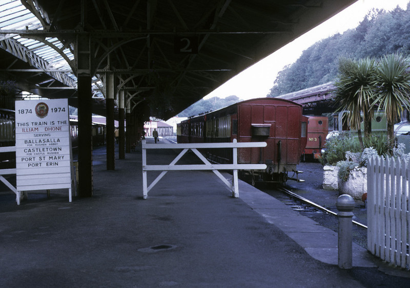 Douglas station, 6 September 1974.  The station was severely rationalised in 1978, when most of its site was converted into a bus station.  Only the platform at far right remains, minus its canopy.  NB the centenary sign for the Port Erin line.  Photo by Les Tindall.