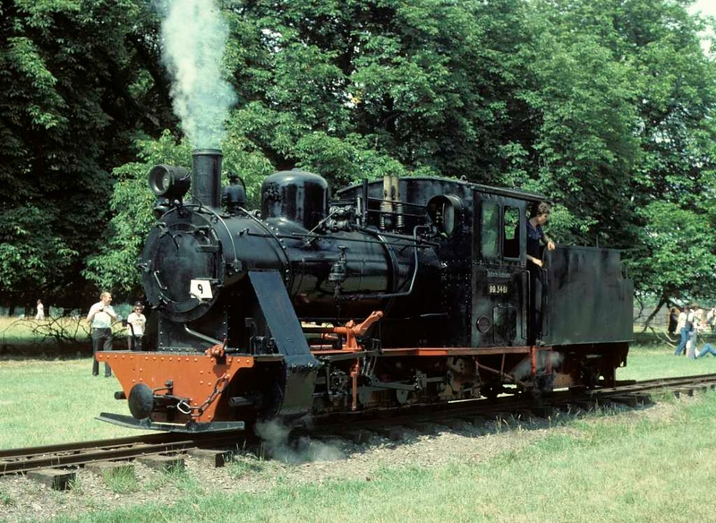 Deutsche Reichsbahn 99.3461, Knebworth Park & Wintergreen Railway, 25 July 1976 1.  Vulkan (Stettin) 0-8-0T+T 3852 / 1925.  This loco came from the Mecklenberg - Pomerania narrow gauge railway in East Germany, closed in 1969.  By 1979 it had moved to the Froissy - Cappy - Dompierre Railway where it is CFCD No 8 - see the last photo in this album.  The CFCD runs alongside the River Somme, near Peronne, in northern France - see photos of my 2012 visit in the French trains section of this site.  Photo by Les Tindall.