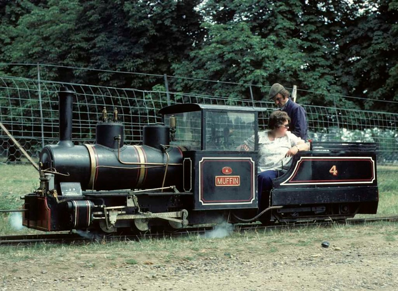 No 4 Muffin, Knebworth Park & Wintergreen Railway, 25 July 1976.  15 inch gauge 0-6-0 built by Berwyn Engineering in 1967.  At the time of this photo it was owned by the Axe & Lyme Light Railway, Combpyne, Devon.  In 2018 it was at the Lappa Valley Steam Railway, Cornwall.  Photo by Les Tindall.
