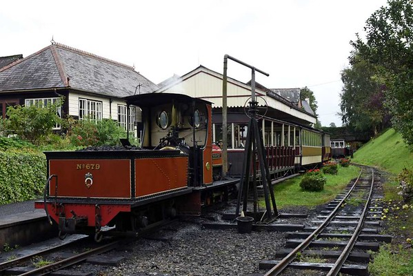 Welcome to the Launceston Steam Railway!  8 September 2017.  The line runs for roughly 2.5 miles along the trackbed of the Southern's North Cornwall line from Okehampton to Halwill Junction (for Bude), Wadebridge and Padstow.  Gauge is 1 foot 11.5 inches.  Four quarry Hunslet locos now run where T9 4-4-0s, Maunsell 2-6-0s and unrebuilt Bulleid Pacifics used to work. including hauling the Padstow portion of the Atlantic Coast Express (dep Waterloo 1100, due Launceston 1605).  Launceston was also served by a Great Western branch from Plymouth via Tavistock.  The Southern and GW stations and goods yards both used to be east of the overbridge in the distance.