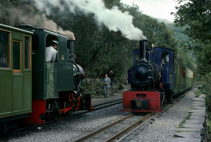 Cyclops & Helen Kathryn, Llanberis Lake Railway, 28 September 1975.  The locos were heading trains to Gilfach Ddu and Penllyn respectively.  Photo by Les Tindall.