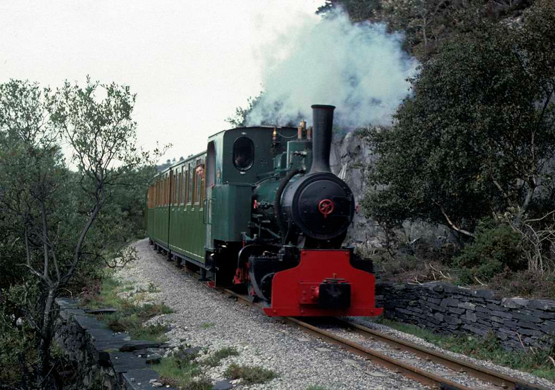 Cyclops, Llanberis Lake Railway, 28 September 1975.  The Jung 0-4-0WT (7509 / 1937) heads towards Gilfach Ddu.  This loco subsequently moved to the Strumpshaw Steam Museum, Norfolk, where it remains in 2016.  It has been renamed Ginette Marie.  Photo by Les Tindall.