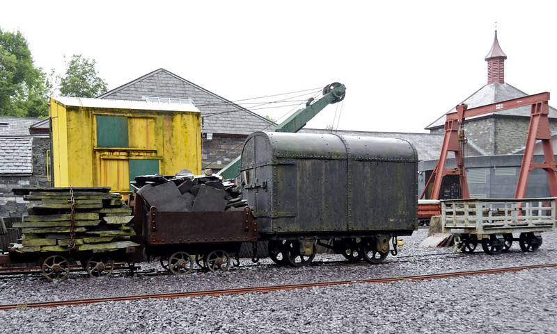 Dinorwic quarry workshops, National Slate Museum, Gilfach Ddu, Llanberis, Sun 21 August 2011 2.  Assorted 2ft gauge rolling stock with a slate wagon at right and a Smith Rodley excavator.