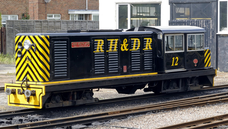 No 12 John Southland, New Romney, Fri 8 June 2012 1 - 1518.  No 12 moves to take over the train brought in by Samson.  It is a 112hp diesel hydraulic designed by the RHDR and built by TMA Engineering in 1983.  Its livery is based on that of the Denver & Rio Grande RR.  John Southland founded a school in New Romney in 1610, and the RHDR carries many of its pupils.