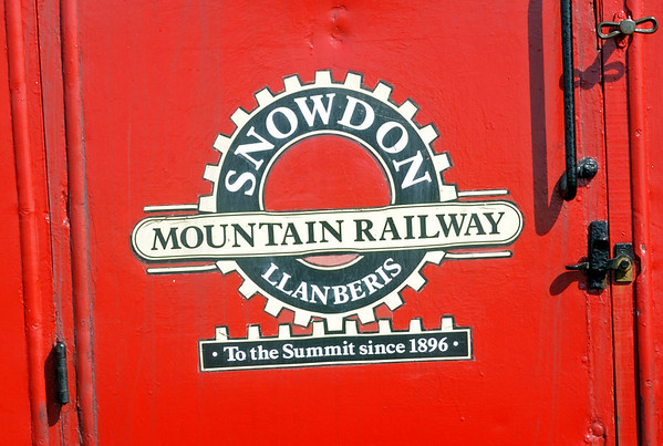 Welcome to the Snowdon Mountain Rly!  Sun 21 August 2011.  The only rack railway in Britain, it climbs 3100 ft in 4.7 miles from Llanberis to the summit of Snowdon, the highest mountain in England and Wales (3561ft).  The return journey takes two and a half hours, including 30 minutes at the summit.  At peak periods all seats are sold out and you have to return on your booked train or walk down!  Trains do not run in winter.  Unusually for Britain, journeys are narrated.  The railway has always been a commercial enterprise and, although some locos and cariages date from the line's opening, it is not a volunteer heritage line.