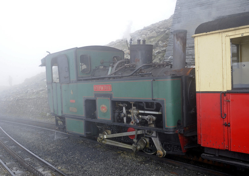 Snowdon Mountain Rly No 4 Snowdon, Summit station, Sun 21 August 2011 - 1510.  No 4 is one of the five locos supplied in 1895-96 for the line's opening by the Swiss Locomotive & Machine Co of Winterthur.  Loco No 1 was destroyed in the opening day accident, and No 5 was out of use in 2011.