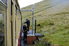 Snowdon Mountain Rly No 4 Snowdon takes water at Halfway station, Sun 21 August 2011 - 1427.  Trains comprise a loco propelling a single carriage.  There are seven steam locos (four serviceable in 2011), four diesel locos, and eight carriages.