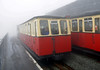 Snowdon Mountain Rly No 6 Padarn leaves Summit station in the mist, Sun 21 August 2011 - 1509.
