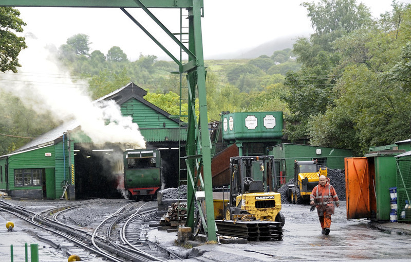 Snowdon Mountain Rly engine shed, Llanberis, Sun 21 August 2011. - 1346.  No 3 Wyddfa is backing out of the shed.  At the time of my visit all four serviceable steam locos, Nos 2, 3, 4 and 6, were working, as well as diesels Nos 11 and 12.